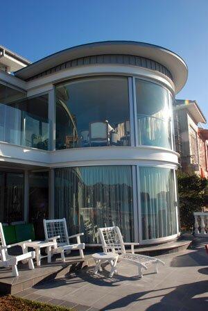 гнутые стекла круглые стекла стеклянные фасады